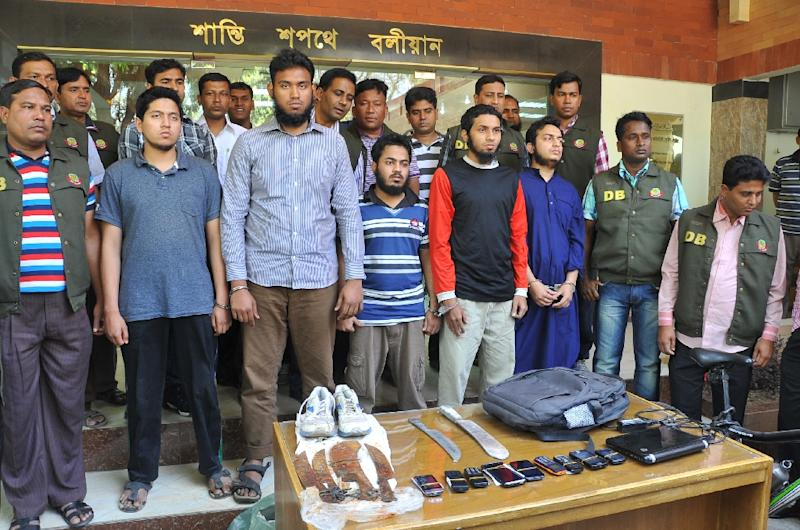 Bangladeshi police display students arrested in connection with the murder of an anti-Islam blogger in Dhaka in 2013 (AFP Photo/)