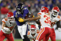 Baltimore Ravens quarterback Lamar Jackson (8) rushes against Kansas City Chiefs defenders in the first half of an NFL football game, Sunday, Sept. 19, 2021, in Baltimore. (AP Photo/Nick Wass)