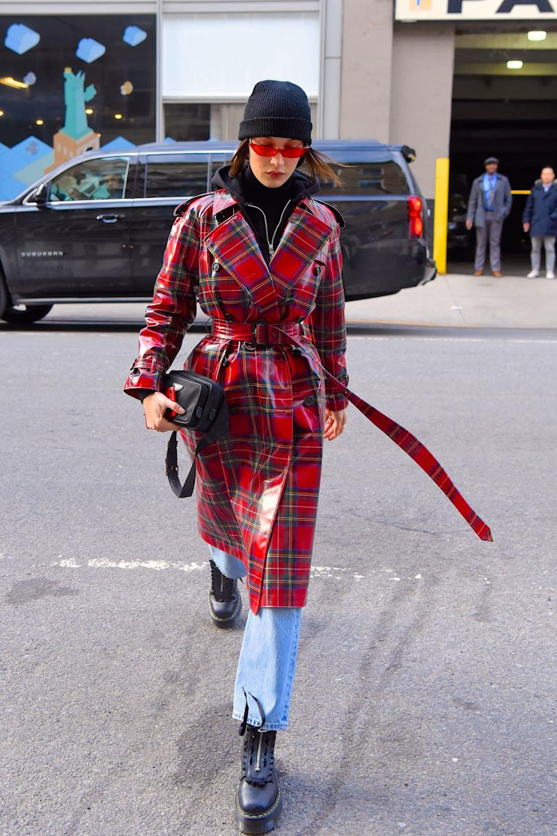 Who: Bella Hadid What: Burberry, Poppy Lissiman sunglasses, Prada bag, Dr. Martens shoes Where: On the street, New York City When: January 31, 2018