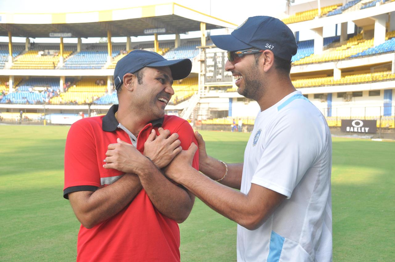 Virender Sehwag and Yuvraj Singh during NKP Salve Challenger Trophy between India Blue and Delhi at Holkar Cricket Stadium in Indore on Sept. 26, 2013. (Photo: IANS)