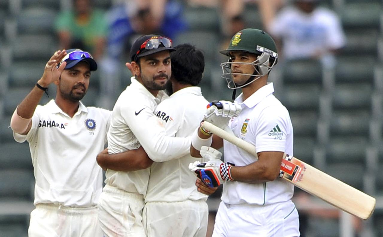 India's cricket players celebrate the dismissal of South Africa's Jean-Paul Duminy (R) during the final day of their test cricket match in Johannesburg, December 22, 2013. REUTERS/Ihsaan Haffejee (SOUTH AFRICA - Tags: SPORT CRICKET)