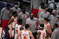 FILE - In this Saturday, March 13, 2021, file photo, Atlanta Hawks coach Nate McMillan, center, talks in a huddle with the team during the first half of an NBA basketball game against the Sacramento Kings in Atlanta. McMillan gives a glimpse of his coaching style when he talks about his playing days. He never cared about the accolades. Just whatever it took to win. He's certainly made the Hawks a lot better since he took over as interim head coach. (AP Photo/Brynn Anderson, File)