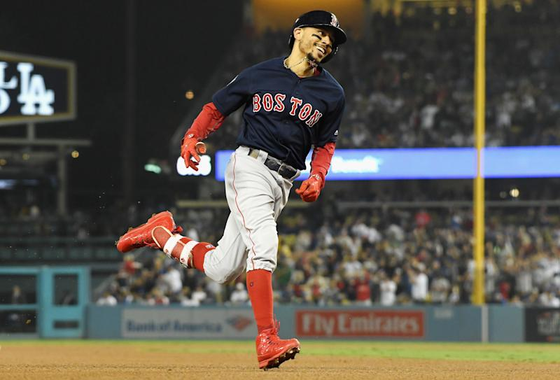 LOS ANGELES, CA - OCTOBER 28: Mookie Betts #50 of the Boston Red Sox celebrates his sixth inning home run against the Los Angeles Dodgers in Game Five of the 2018 World Series at Dodger Stadium on October 28, 2018 in Los Angeles, California. (Photo by Harry How/Getty Images)