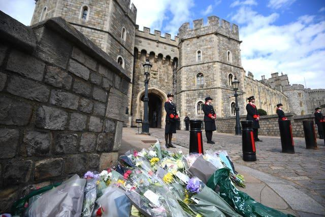 Flowers left outside Windsor Castle following the announcement of the death of the Duke of Edinburgh