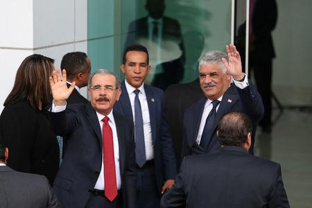 President of the Dominican Republic Danilo Medina and Chancellor of the Dominican Republic Miguel Vargas wave as they arrive to attend Venezuela's government and opposition coalition meeting in Santo Domingo, Dominican Republic February 7, 2018. REUTERS/Ricardo Rojas