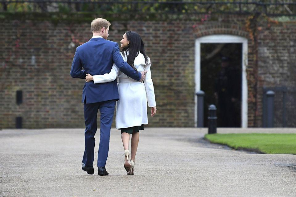<p>Following their engagement announcement on 27 November 2017, Prince Harry and Meghan Markle walked away from the paparazzi in the grounds of Kensington Palace with their arms around each other's backs. This was a rare but touching moment of PDA from royals and one we couldn't love more. </p>