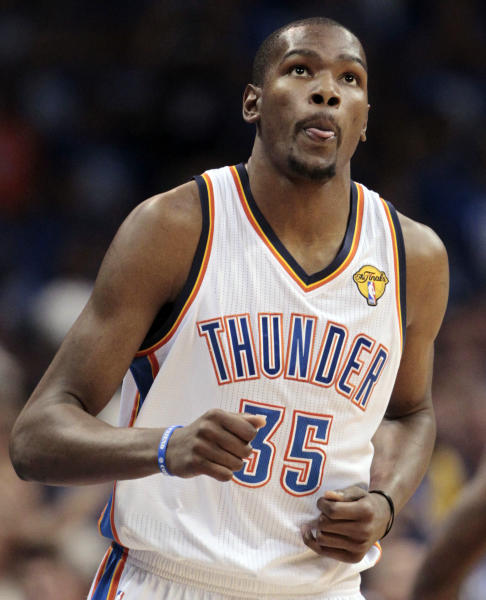 File-This June 12, 2012 file photo shows Oklahoma City Thunder forward Kevin Durant looking at the scoreboard against the Miami Heat during the first half at Game 1 of the NBA finals basketball series in Oklahoma City. Durant is engaged to Minnesota Lynx guard Monica Wright. Wright confirmed the engagement following Minnesota's 91-59 victory over the Phoenix Mercury on Sunday July 7, 2013. (AP Photo/Jeff Roberson, File)