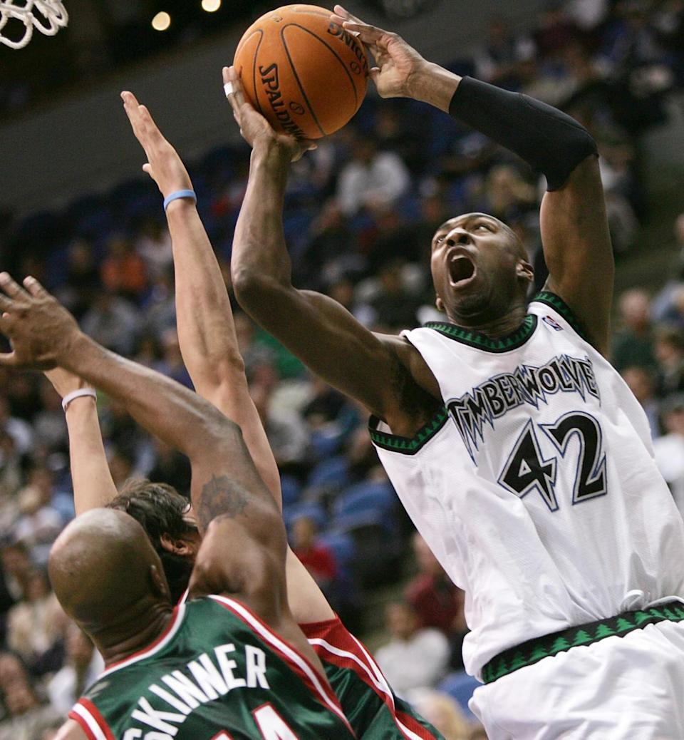 Vin Baker tries to score against the Bucks while playing for the Timberwolves in 2006.