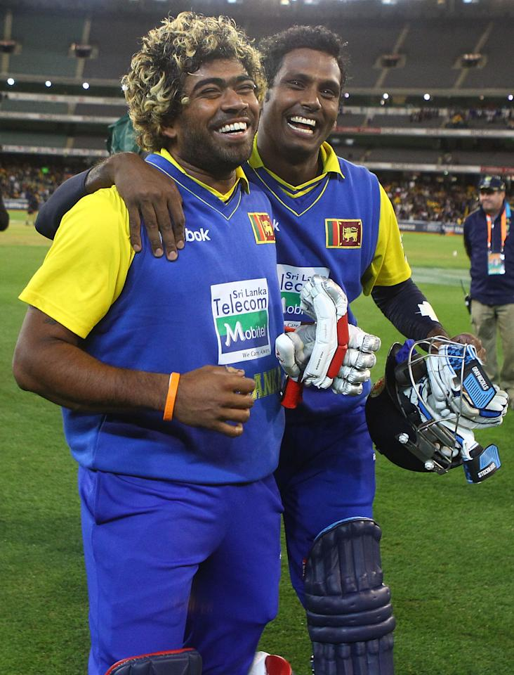 MELBOURNE, AUSTRALIA - NOVEMBER 03: Lasith Malinga and Angelo Mathews of Sri Lanka celebrate after after Sri Lanka defeated Australia during the Commonwealth Bank Series match between Australia and Sri Lanka at Melbourne Cricket Ground on November 3, 2010 in Melbourne, Australia.  (Photo by Robert Cianflone/Getty Images)
