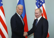 FILE - In this March 10, 2011, file photo, then-Vice President Joe Biden, left, shakes hands with Russian Prime Minister Vladimir Putin in Moscow, Russia. The Kremlin said Friday March 19, 2021, that President Vladimir Putin's offer for a quick call with U.S. President Joe Biden was intended to prevent bilateral ties from completely falling apart over Biden's description of the Russian leader as a killer. (AP Photo/Alexander Zemlianichenko, File)