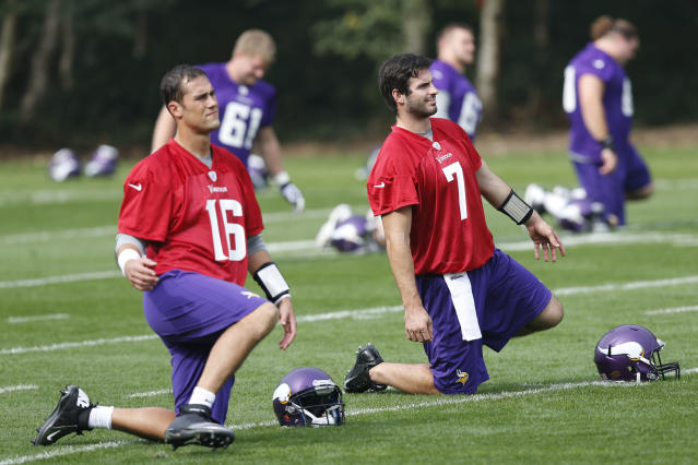 Minnesota Vikings' quarterback Christian Ponder, right, and quarterback Matt Cassel, left, warm up during their football practice at the Grove Hotel in Watford, England, Wednesday, Sept. 25, 2013. The Vikings play Pittsburgh Steelers on Sunday in a NFL football game at Wembley Stadium in London. (AP Photo/Sang Tan)