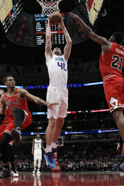 Charlotte Hornets center Cody Zeller, center, shoots against the Chicago Bulls during the first half of an NBA basketball game in Chicago, Thursday, Feb. 20, 2020. (AP Photo/Nam Y. Huh)