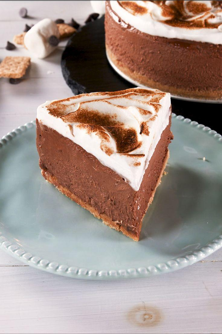 """<p>This light, fluffy cake is covered in a thick layer of toasted merengue.</p><p>Get the recipe from <a href=""""https://www.delish.com/cooking/recipe-ideas/a28580956/smores-mousse-cake-recipe/"""" rel=""""nofollow noopener"""" target=""""_blank"""" data-ylk=""""slk:Delish"""" class=""""link rapid-noclick-resp"""">Delish</a>.</p>"""