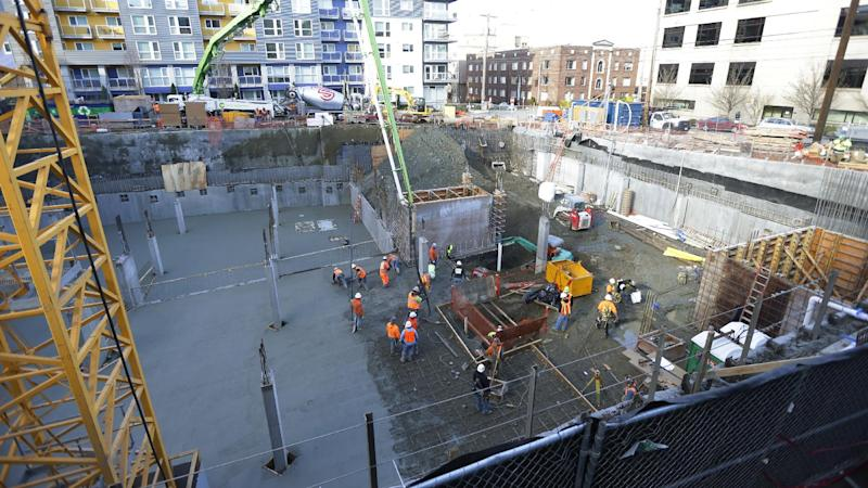 The construction site in Seattle where workers discovered what is believed to be an ice age mammoth tusk is shown Wednesday, Feb. 12, 2014. Work pouring cement at the site was continuing, but workers blocked off the area at the center of the photo where the tusk was found. Paleontologists from the University of Washington hope to move the tusk to a museum on campus. (AP Photo/Ted S. Warren)