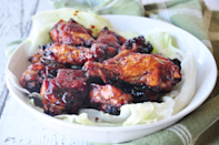 """<p>""""I made these for the Super Bowl and everyone raved. I would definitely make these again for guests. Very simple and easy."""" <i>-Chef Emstar</i> <b><a href=""""http://www.food.com/recipe/chicken-wings-in-honey-bbq-sauce-64639?oc=PTNR-YahooFood-favorite-chicken-wing-recipes"""" rel=""""nofollow noopener"""" target=""""_blank"""" data-ylk=""""slk:Get the Recipe>>"""" class=""""link rapid-noclick-resp"""">Get the Recipe>></a></b><br></p><p><i>Recipe by <a href=""""http://share.food.com/community/Susie-in-Texas/style.esi?member_id=42720?oc=PTNR-YahooFood-favorite-chicken-wing-recipes"""" rel=""""nofollow noopener"""" target=""""_blank"""" data-ylk=""""slk:Susie in Texas"""" class=""""link rapid-noclick-resp"""">Susie in Texas</a>; Photo by <a href=""""http://share.food.com/community/SharonChen/style.esi?member_id=1800054678?oc=PTNR-YahooFood-favorite-chicken-wing-recipes"""" rel=""""nofollow noopener"""" target=""""_blank"""" data-ylk=""""slk:SharonChen"""" class=""""link rapid-noclick-resp"""">SharonChen</a> </i></p>"""