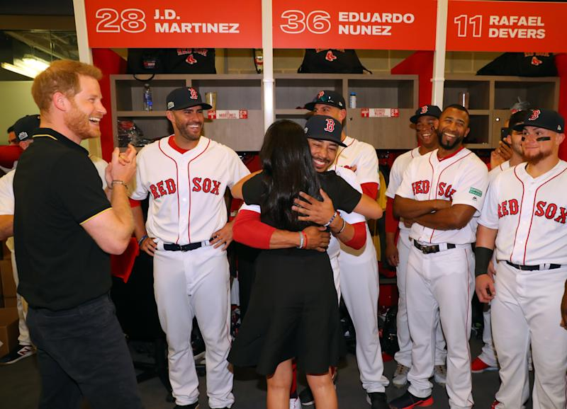 LONDON, ENGLAND - JUNE 29: Meghan, Duchess of Sussex greets distant relative Mookie Betts #50 of the Boston Red Sox while Prince Harry, Duke of Sussex looks on in the Red Sox clubhouse before game one of the London Series between the New York Yankees and the Boston Red Sox at London Stadium on Saturday, June 29, 2019 in London, England. (Photo by Alex Trautwig/MLB via Getty Images)