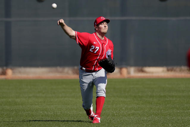 Cincinnati Reds baseball player Trevor Bauer throws during the teams' first spring training practice, Saturday, Feb. 15, 2020, in Goodyear, Ariz. (AP Photo/Matt York)