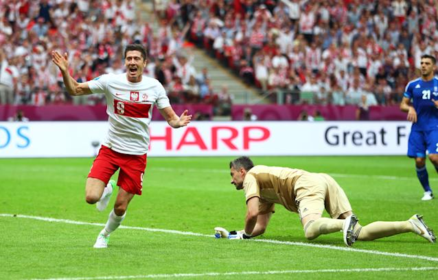 WARSAW, POLAND - JUNE 08: Robert Lewandowski of Poland celebrates scoring the opening goal during the UEFA EURO 2012 Group A match between Poland and Greece at National Stadium on June 8, 2012 in Warsaw, Poland. (Photo by Michael Steele/Getty Images)