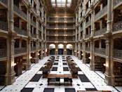 """<p>Baltimore's <a href=""""http://peabodyevents.library.jhu.edu/"""" rel=""""nofollow noopener"""" target=""""_blank"""" data-ylk=""""slk:George Peabody Library"""" class=""""link rapid-noclick-resp"""">George Peabody Library</a> is so much more than a home for books: It also serves as an extravagant wedding and event venue for those willing to rent the space. With five tiers of balconies and more than 300,000 volumes of reading material, the library offers an elegant setting for wining, dining, and, of course, researching.</p>"""