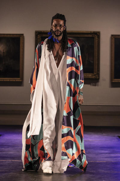 The Travis Oestreich collection is modeled during the dapperQ fashion show at the Brooklyn Museum on Thursday, Sept. 5, 2019, in New York. (AP Photo/Jeenah Moon)