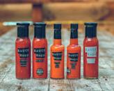"""<p><a class=""""link rapid-noclick-resp"""" href=""""https://www.sauceshop.co/collections/gifts-and-collections/products/ultimate-chilli-collection-set-of-10?variant=31759396732997"""" rel=""""nofollow noopener"""" target=""""_blank"""" data-ylk=""""slk:SHOP"""">SHOP</a></p><p>Christmas dinner is great, but it's rarely experimental. Gift someone a set from the Sauce Shop – including the brand's very only blends of smoky chipotle ketchup, green sriracha and more – so they can swap the gloopy gravy for something a little bit more adventurous. Will the home cook be bothered by them dousing the turkey in extra spicy habanero hot sauce? Almost certainly, but they'll be in too much pain to care.</p>"""