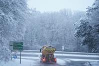 A snow plough clears the A69 near Stocksfield, Newcastle. Heavy snow and freezing rain is set to batter the UK this week, with warnings issued over potential power cuts and travel delays. (Photo by Owen Humphreys/PA Images via Getty Images)