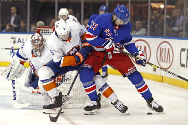 New York Islanders defenseman Ryan Pulock (6) defends New York Rangers center Brett Howden (21) in front of Islanders goaltender Semyon Varlamov (40) during the second period of an NHL hockey game, Monday, Jan. 13, 2020, in New York. (AP Photo/Kathy Willens)