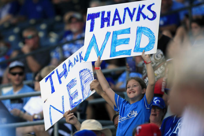 Fans hold signs honoring Kansas City Royals manager Ned Yost during the sixth inning of a baseball game against the Minnesota Twins at Kauffman Stadium in Kansas City, Mo., Sunday, Sept. 29, 2019. (AP Photo/Orlin Wagner)