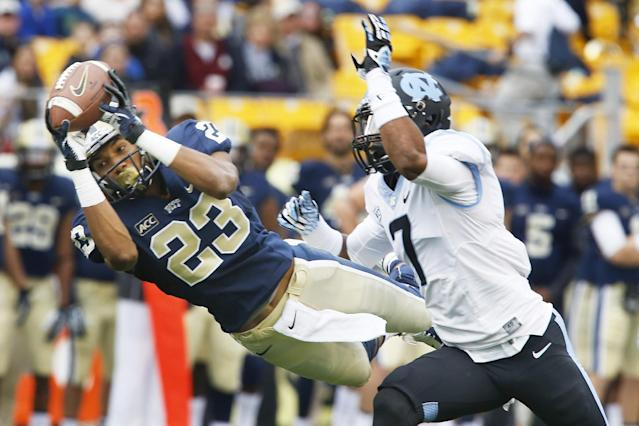 Pittsburgh wide receiver Tyler Boyd (23) dives to make a catch for a first down in front of North Carolina cornerback Tim Scott (7) during the first quarter of an NCAA football game, Saturday, Nov. 16, 2013 in Pittsburgh. The catch helped set up Pitt's first field goal(AP Photo/Keith Srakocic)