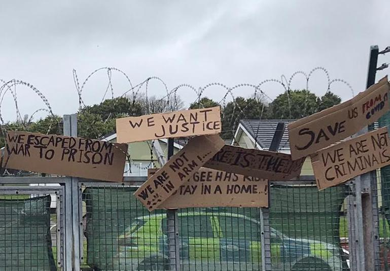 Protest signs put up by asylum seekers housed at the Penally military camp last month call for 'justice' and aid. (Patrick Connellan)