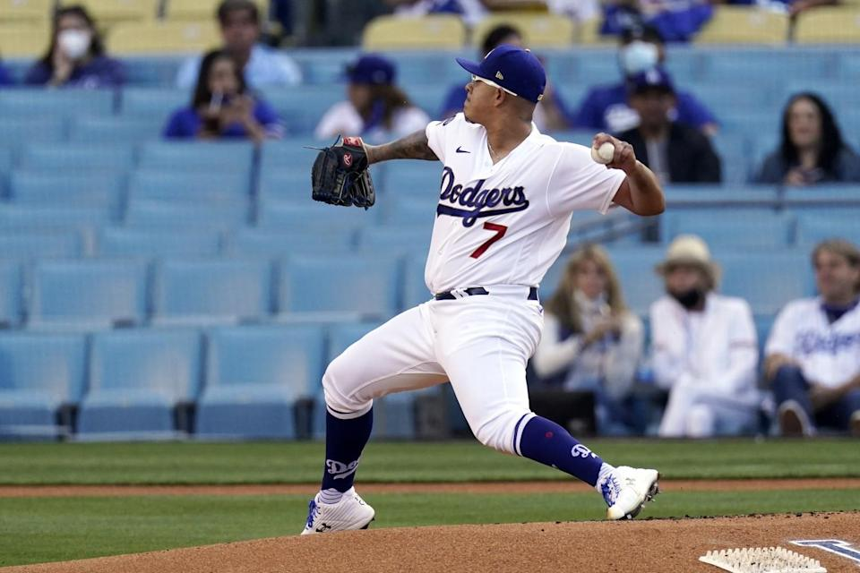 The Dodgers' Julio Urías delivers to the plate during the first inning April 10, 2021.