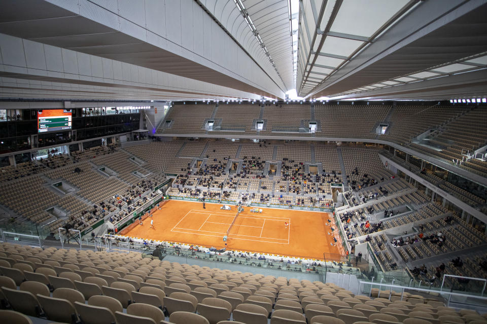 PARIS, FRANCE October 11. A general view of Rafael Nadal of Spain in action against Novak Djokovic of Serbia in the Men's Singles Final on Court Philippe-Chatrier with the roof closed during the French Open Tennis Tournament at Roland Garros on October 11th 2020 in Paris, France. (Photo by Tim Clayton/Corbis via Getty Images)