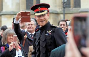 Prince Harry greets onlookers after Field of Remembrance ceremony