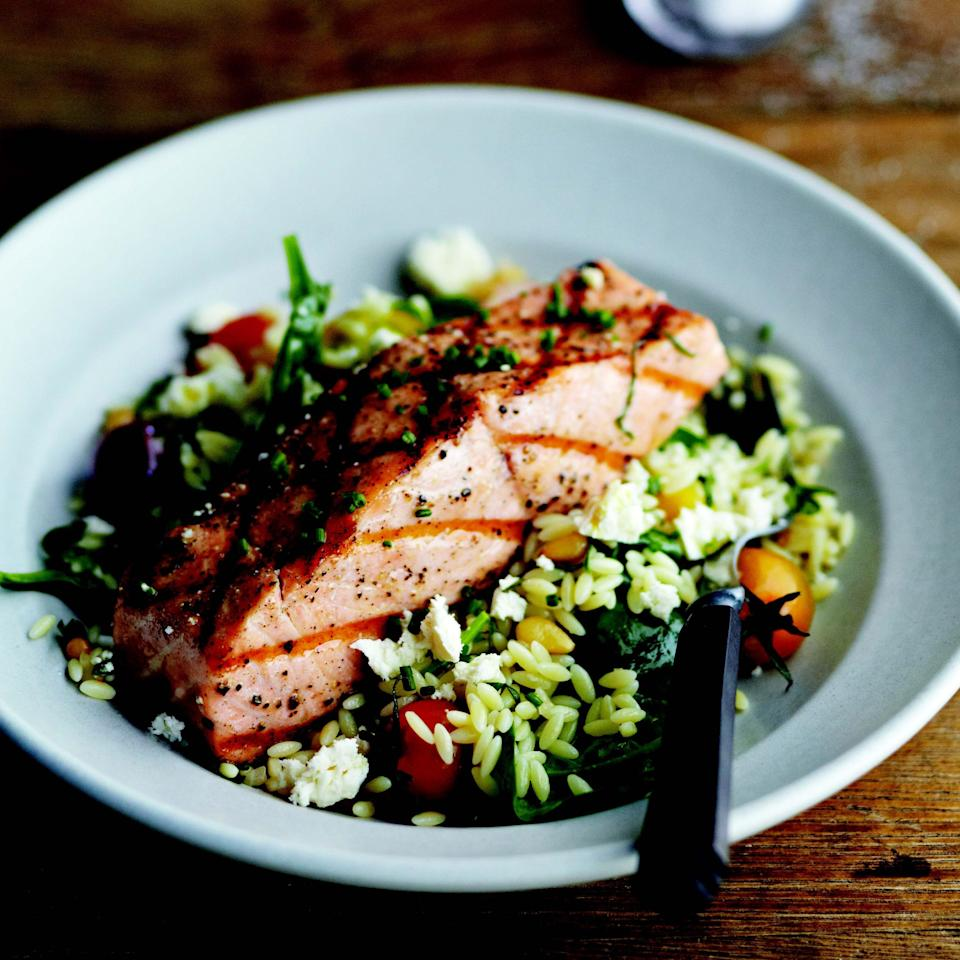 "While topping the vegetable and cheese-flecked orzo with grilled salmon turns it into a complete meal, the pasta salad is equally delicious on its own. <a href=""https://www.epicurious.com/recipes/food/views/grilled-salmon-with-orzo-feta-and-red-wine-vinaigrette-51163620?mbid=synd_yahoo_rss"" rel=""nofollow noopener"" target=""_blank"" data-ylk=""slk:See recipe."" class=""link rapid-noclick-resp"">See recipe.</a>"