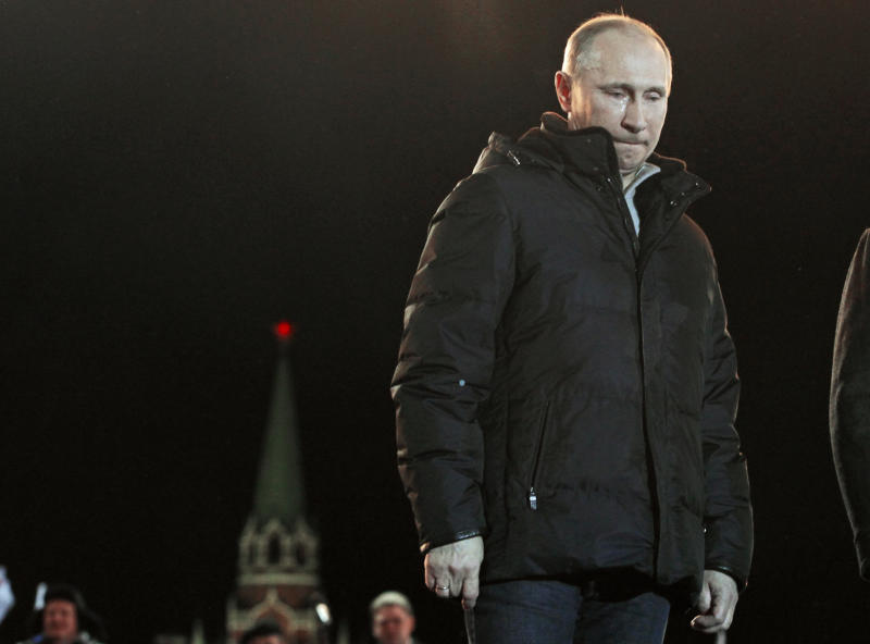 In this Sunday, March 4, 2012 file photo, Russian Prime Minister Vladimir Putin has tears in his eyes as he reacts at a massive rally of his supporters during presidential election at Manezh square outside the Kremlin, in Moscow. Vladimir Putin's return to the presidency on Monday May 7, 2012 will technically give him greater powers than he wielded as prime minister. The irony is that his position will be arguably weaker than at any time since he first came to power more than 12 years ago. (AP Photo/Ivan Sekretarev)