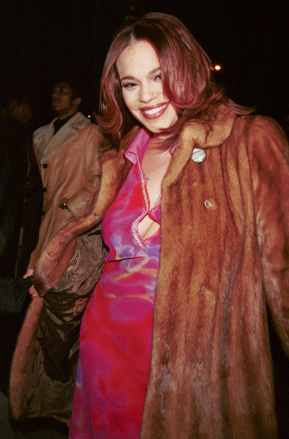 Through the highs and lows, the Bad Boy family always supports each other. Here Evans wore shades of red — even in her hair — for Diddy's fashion show. Back then, he was known as Puffy.