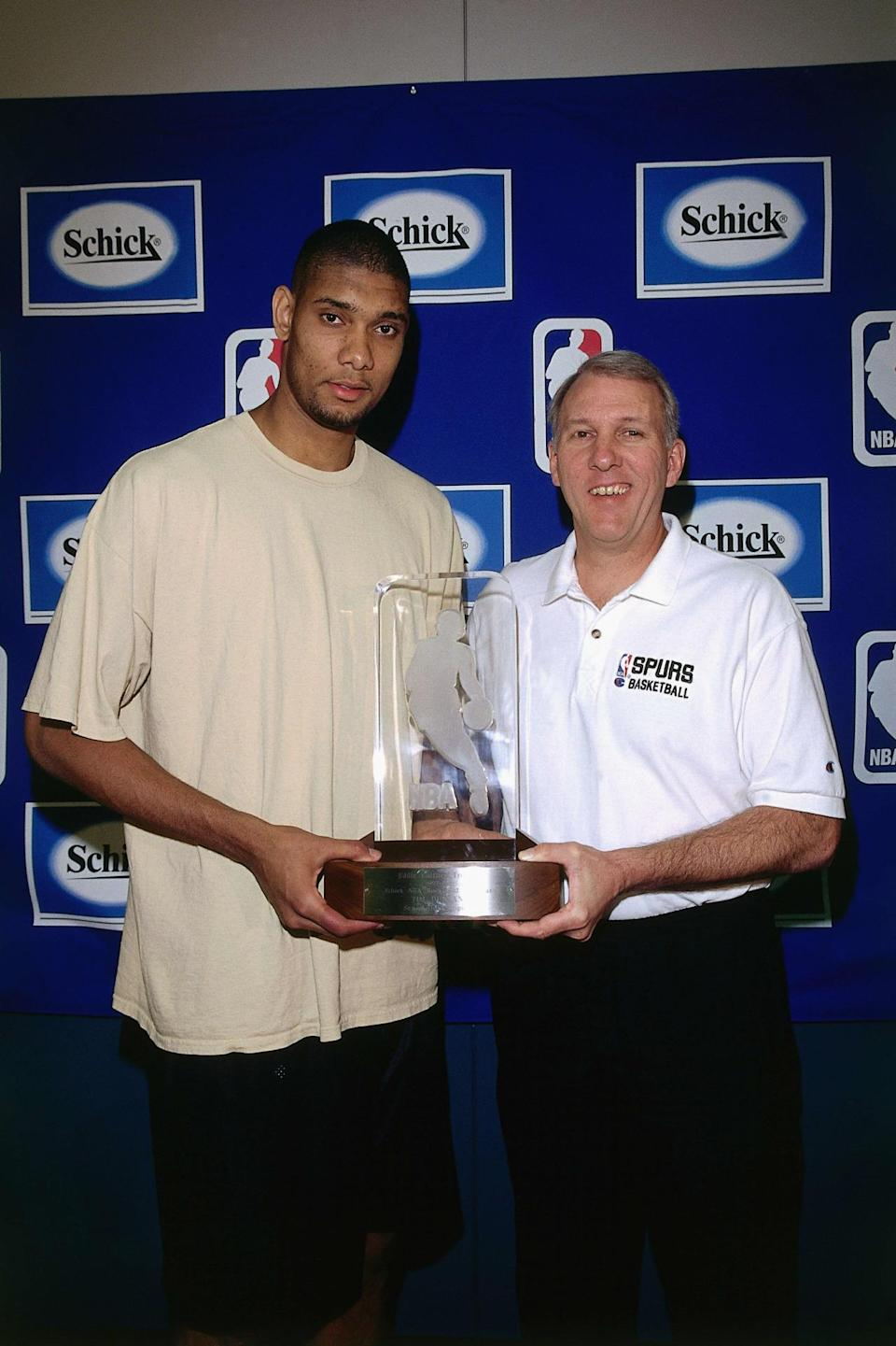 <p>1998: Tim Duncan #21 of the San Antonio Spurs poses for a portrait with Gregg Popovich during the Rookie of the Year press conference on April 27, 1998 in San Antonio, Texas.<br></p>