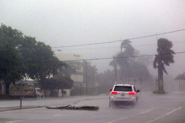 <p><strong>Boca Raton</strong><br>A lone car drives down a road as Hurricane Irma strikes on Sept. 10, 2017 in Boca Raton, Fla. (Photo: Marc Serota/Getty Images) </p>