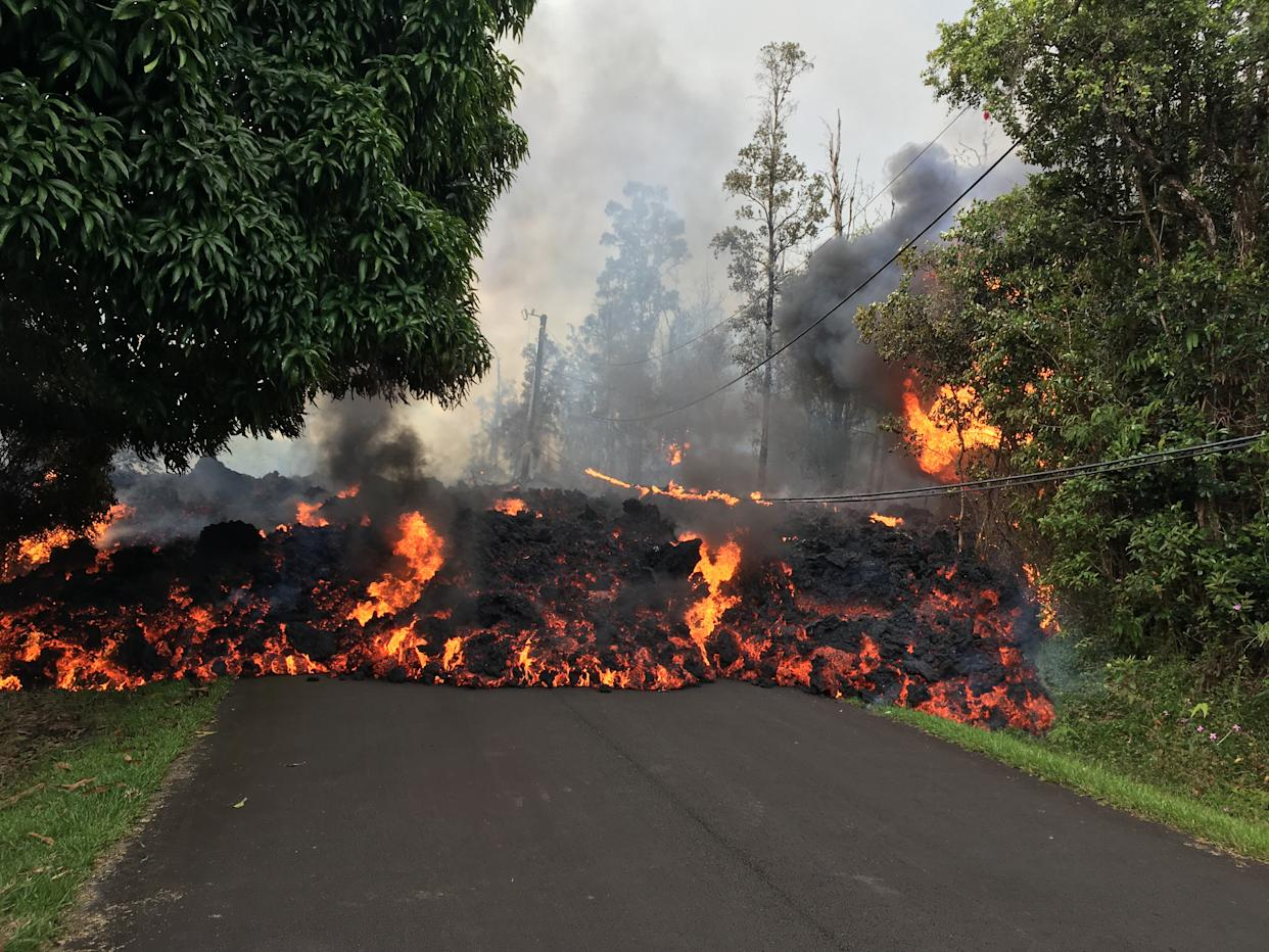 Lava flows from the crater of Kilauea volcano as dozens of structures, including at least nine homes, have been destroyed by scorching lava flows following a massive volcano eruption on Hawaii's Big Island, USA on May 6, 2018. Hawaii's Kilauea volcano erupted Thursday triggering a series of earthquakes that have continued to rattle the island as burning blood-red lava spewed hundreds of feet in the air from cracks in the ground. The strongest earthquakes were felt Friday when a 5.6-magnitude temblor was followed an hour later by a 6.9-magnitude earthquake, according to the U.S. Geological Survey (USGS).
