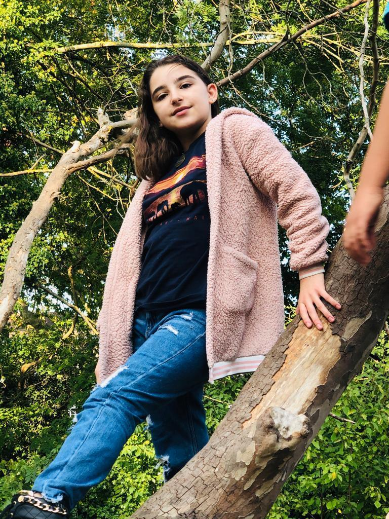 Lily pictured here climbing a tree was last seen with her sister on April 3Met Police