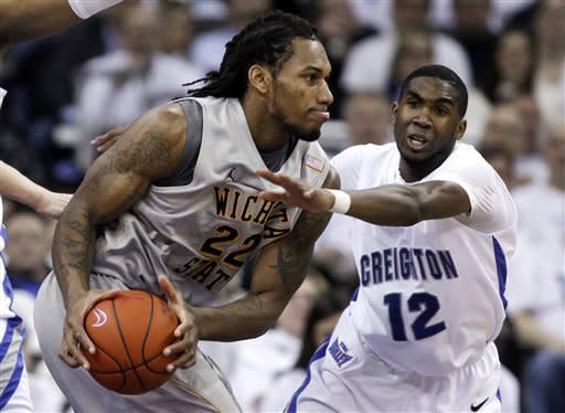 Wichita State's Carl Hall (22) is defended by Creighton's Jahenns Manigat (12) in the first half of their NCAA college basketball game in Omaha, Neb., Saturday, Feb. 11, 2012. (AP Photo/Nati Harnik)