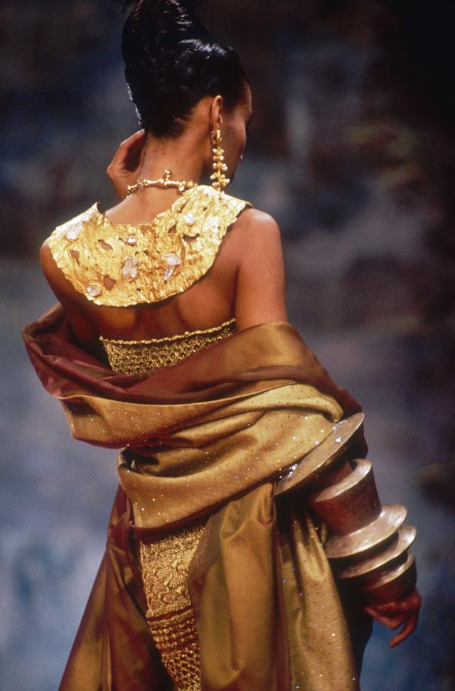 A model wears a gold design from the designer's spring/summer 1991 couture collection.