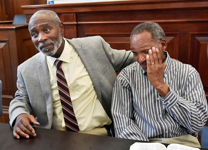 Nathan Myers, left, embraces his uncle, Clifford Williams, during a news conference after their 1976 murder convictions were overturned Thursday, March 28, 2019.