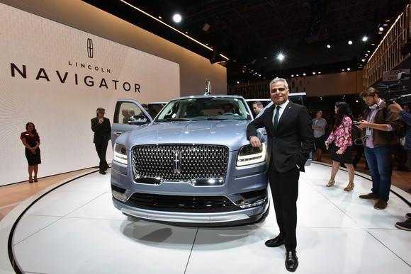 Kumar Galhotra standing next to a 2018 Lincoln Navigator SUV on Lincoln's stand at the 2017 New York International Auto Show.