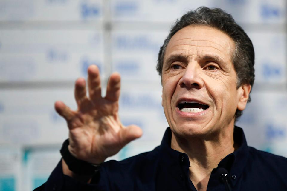 In this Tuesday, March 24, 2020, file photo, New York Gov. Andrew Cuomo speaks during a news conference against a backdrop of medical supplies at the Jacob Javits Center that will house a temporary hospital in response to the COVID-19 outbreak, in New York.
