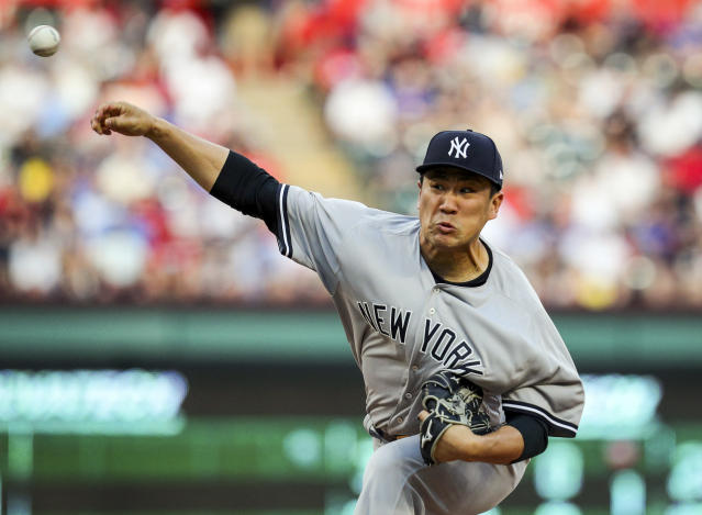 New York Yankees starting pitcher Masahiro Tanaka (19) delivers a pitch against the Texas Rangers in the first inning of a baseball game Monday, May 21, 2018, in Arlington, Texas. (AP Photo/Richard W. Rodriguez)