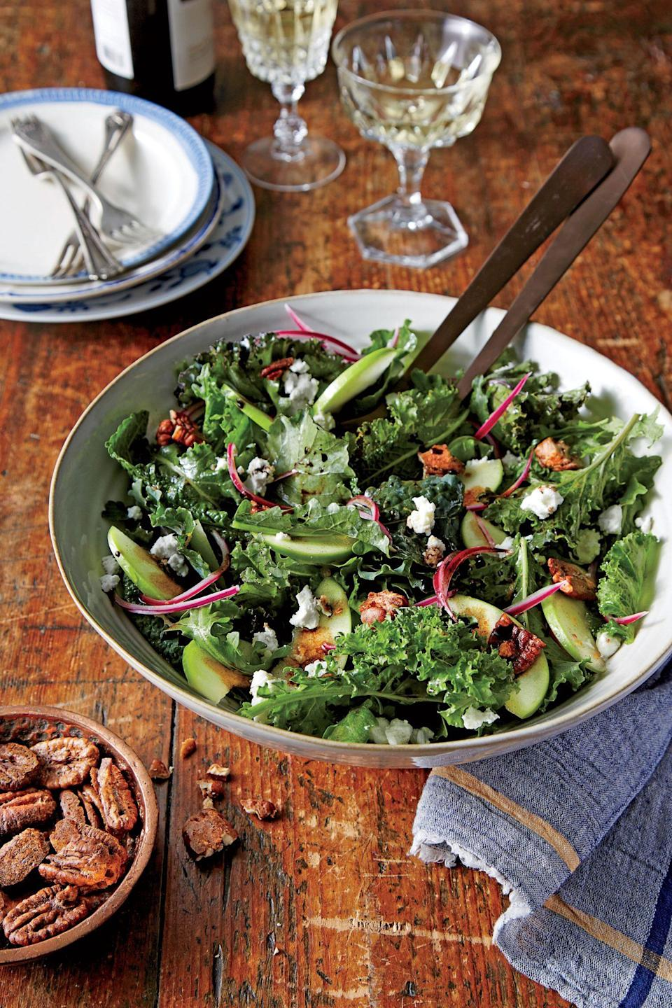 """<p><strong>Recipe: <a href=""""https://www.southernliving.com/recipes/apple-and-goat-cheese-salad-with-candied-pecans-recipe"""" rel=""""nofollow noopener"""" target=""""_blank"""" data-ylk=""""slk:Apple and Goat Cheese Salad with Candied"""" class=""""link rapid-noclick-resp"""">Apple and Goat Cheese Salad with Candied </a><a href=""""https://www.southernliving.com/recipes/apple-and-goat-cheese-salad-with-candied-pecans-recipe"""" rel=""""nofollow noopener"""" target=""""_blank"""" data-ylk=""""slk:Pecans"""" class=""""link rapid-noclick-resp"""">Pecans</a></strong></p> <p>Spicy, paprika-laden pecans provide a smoky element to this crispy apple and winter greens salad. Creamy goat cheese mellows the strong flavors and the vinaigrette brings fall vibes with allspice, orange zest, and lemon juice. </p>"""