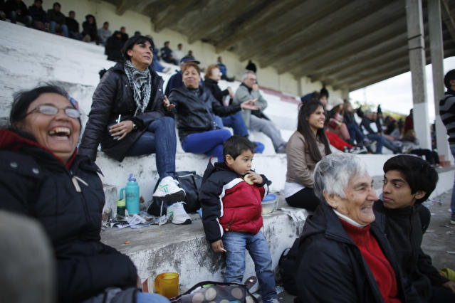 "Fans of the soccer team ""Papa Francisco,"" or Pope Francis, watch their team's debut game against Trefules in Lujan, Argentina, Saturday, April 12, 2014. The new semi-professional team named their team in honor of the Argentine pontiff. (AP Photo/Victor R. Caivano)"