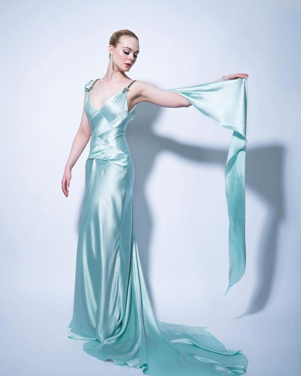 <p>Ditching the '18th Century period costumes of <em>The Great</em>, Elle Fanning turned to more modern royalty for inspiration in this sleek, stunning, ice-blue Gucci gown, giving us pure Grace Kelly realness.</p>