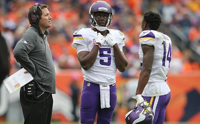 Oct 4, 2015; Denver, CO, USA; Minnesota Vikings quarterback Teddy Bridgewater (5) talks with Minnesota Vikings quarterbacks coach Scott Turner (left) and wide receiver Stefon Diggs (14) during the first half against the Denver Broncos at Sports Authority Field at Mile High. Mandatory Credit: Chris Humphreys-USA TODAY Sports